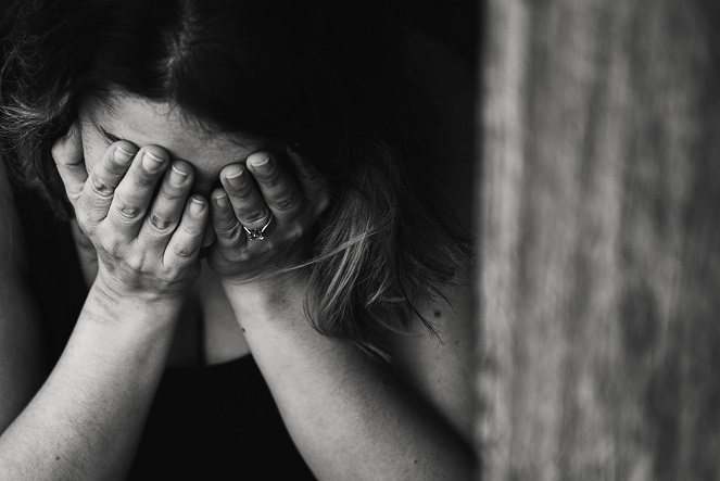 counselling for anxiety that causes woman to hide her face behind her hands