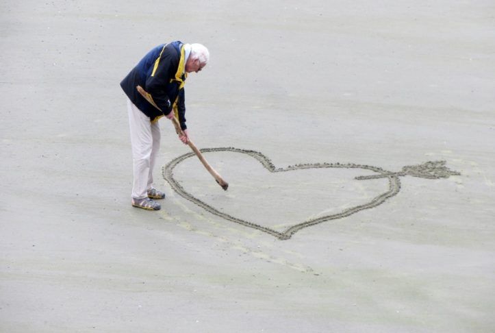 man-drawing-a-heart-in-the-sand