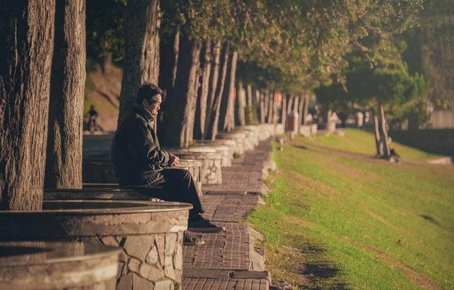 man sitting on concrete base
